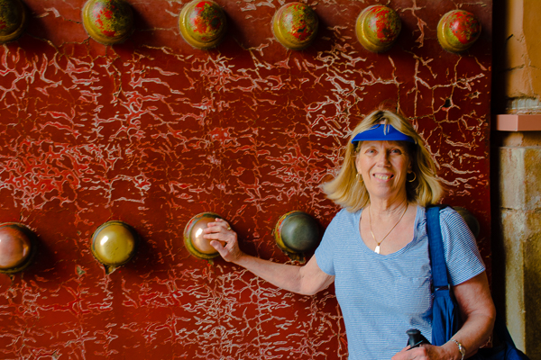 Rebecca rubbing ball for luck in the Forbidden City, Beijing.