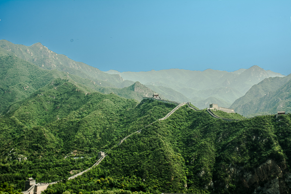 The Great Wall extends through mountainous topography.