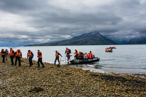 Arriving by zodiacs at the Aguila Glacier in Agostini Sound, Chile.