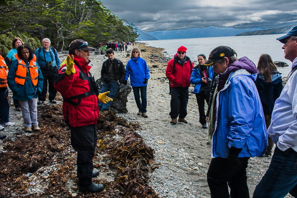 Guide describing the island and the Aguila Glacier in Agostini Sound, Chile.