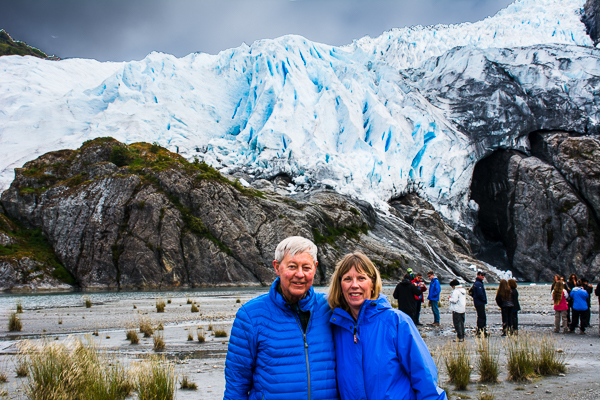 Sunny and Rebecca with the Aguila Glacier in Agostini Sound, Chile.