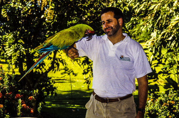 Nature guide Jeff holding a Macaw.
