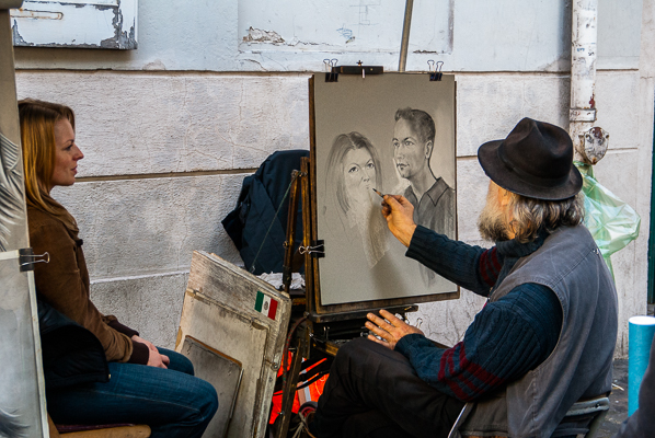 Painter with model in Montmartre secton of Paris, France.