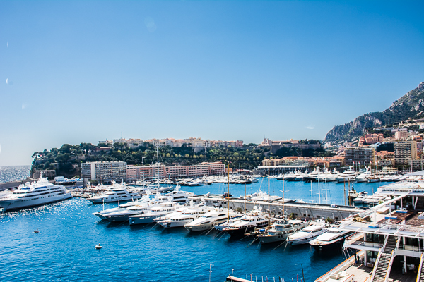 Yachts docked at Monaco with view towards The Rock.