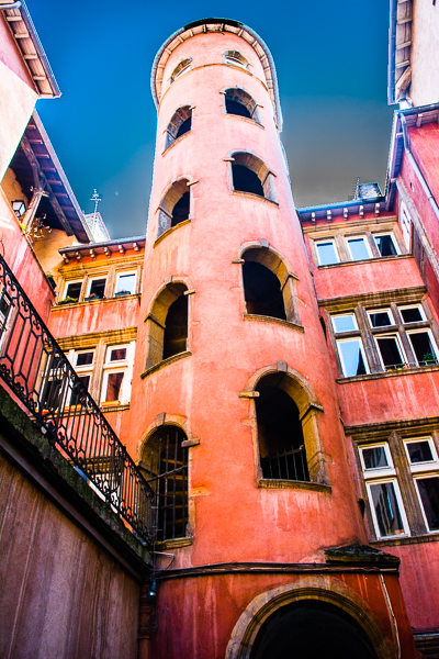 Tower in courtyard reached by a passageway in Lyon, France.