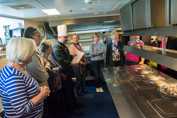 Chef describing how food is prepared in the galley.