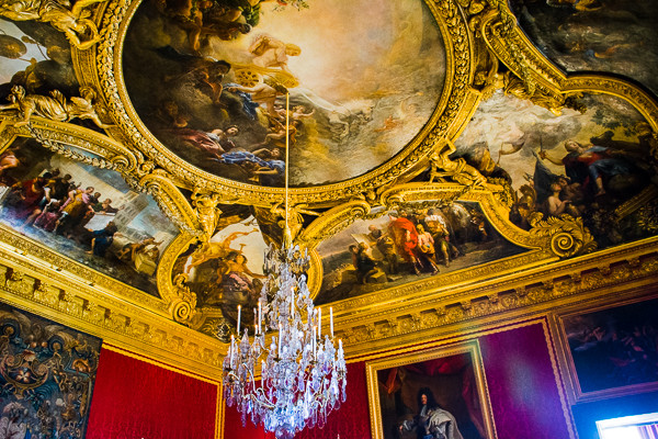 Painting on the ceiling of a room in the Versailles Palace, France.