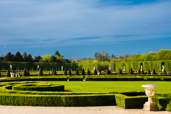 Palace gardens with statues in Versailles, France.