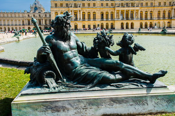 Statue in the palace gardens Versailles, France.
