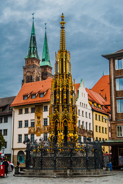 Schoner (Beautiful) Fountain in Nuremberg. The St. Sebaldus Church Towers are also seen.