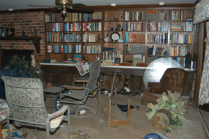 Books in dining room after Hurrican Katrina.